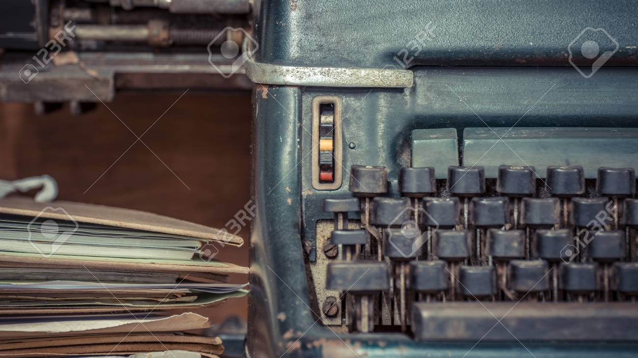 Stock Photo - Typewriter antique vintage style with old documents or old  letter for writer on wooden desk zoom in front view of typewriter, writer  or editor ... - Typewriter Antique Vintage Style With Old Documents Or Old Letter