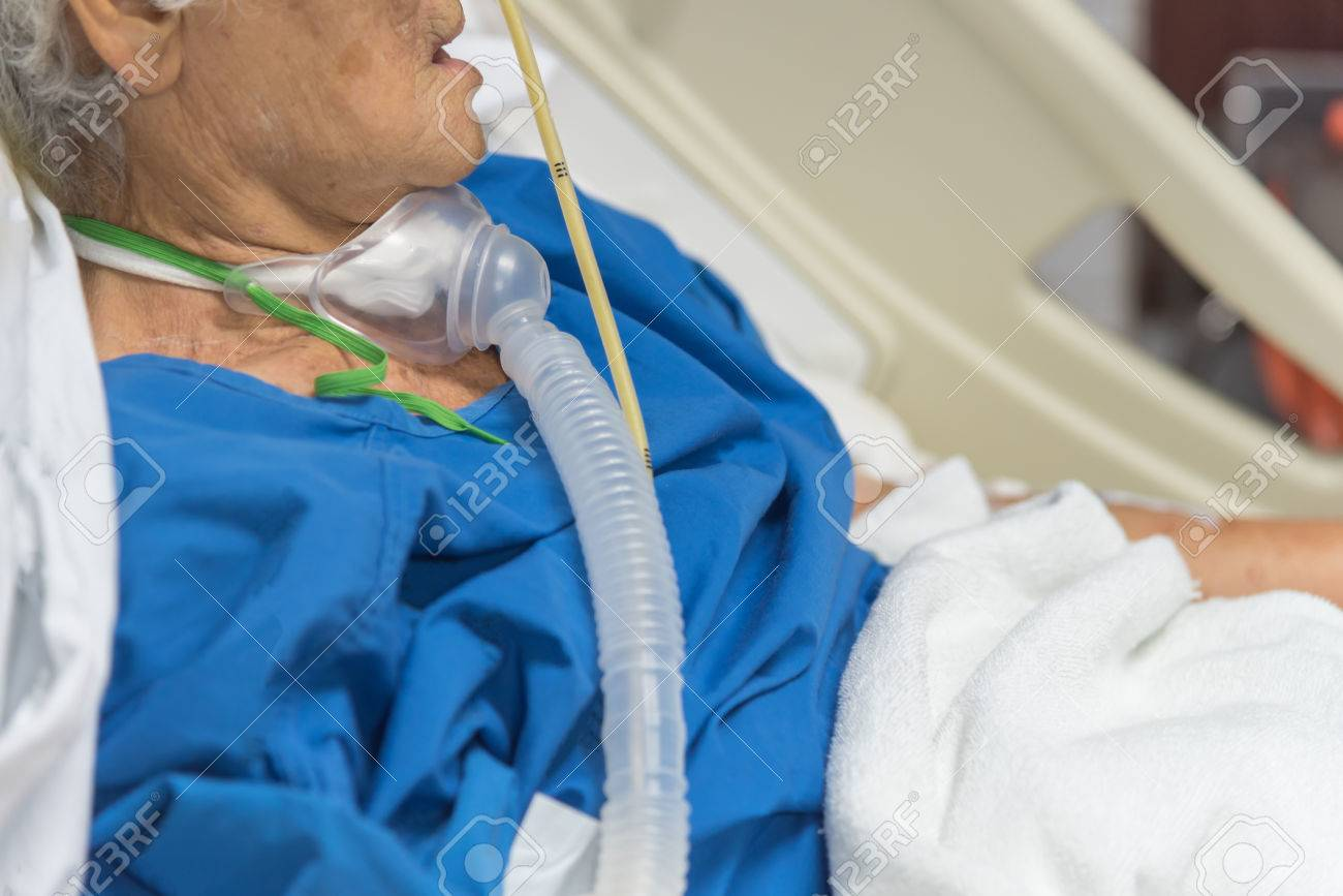 Patient asian elder women 80s do tracheostomy use ventilator for breathing help on bed in the hospital. - 80164059