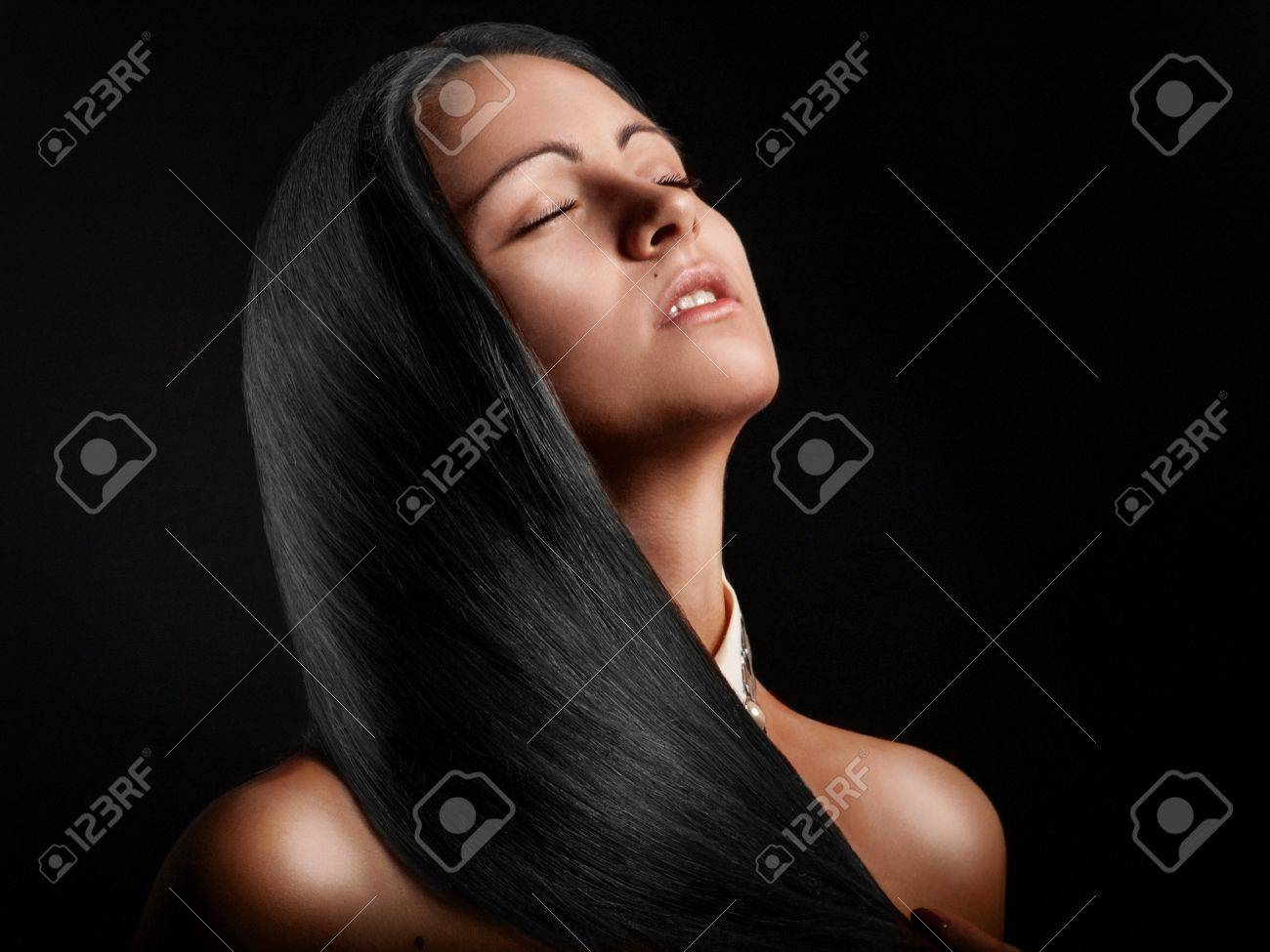 Hot brunette girl with perfect straight hair Stock Photo - 17497275