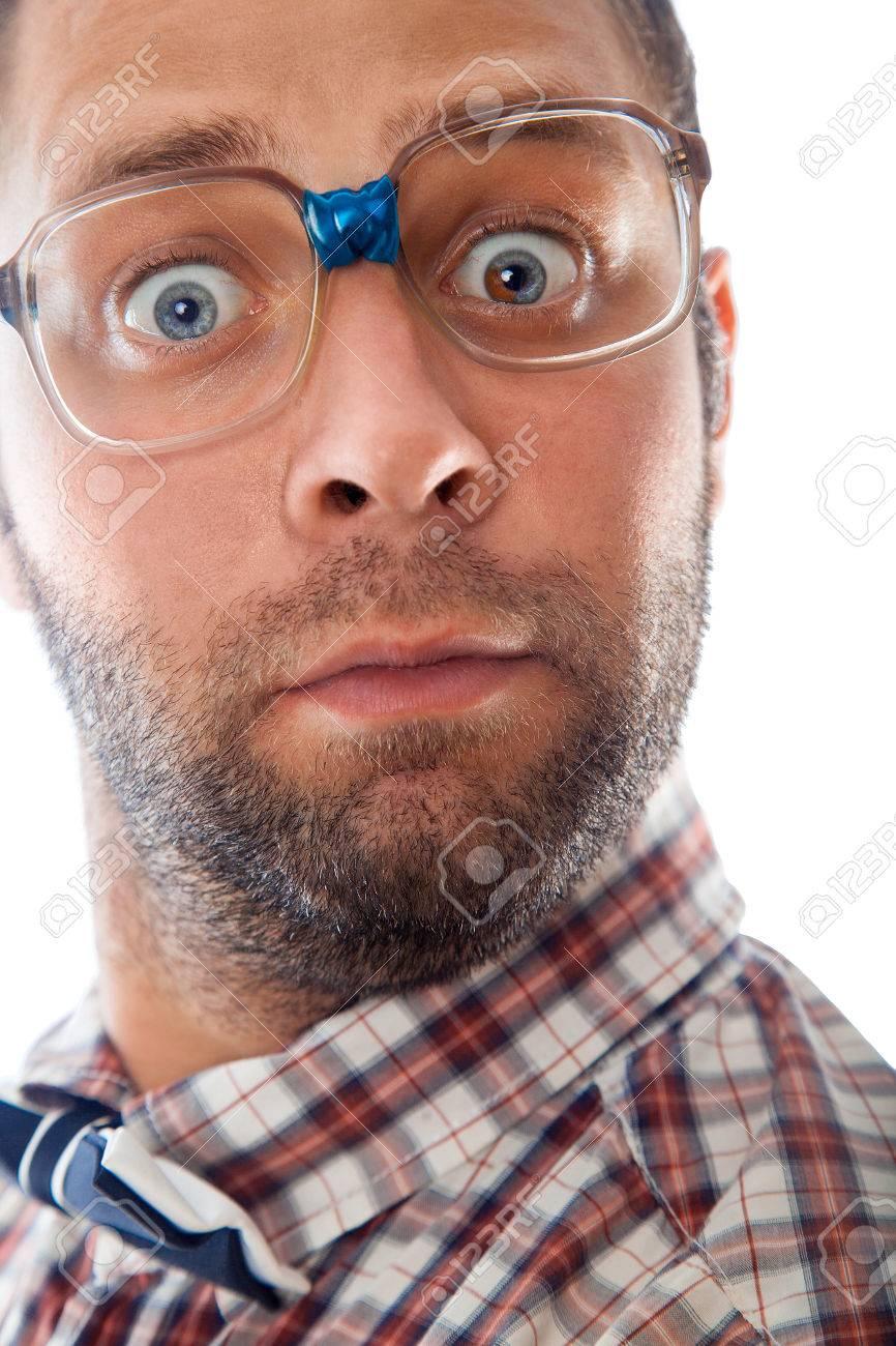 Geekin Gorgeous close up portrait of surprised elegant geek in glasses in studio