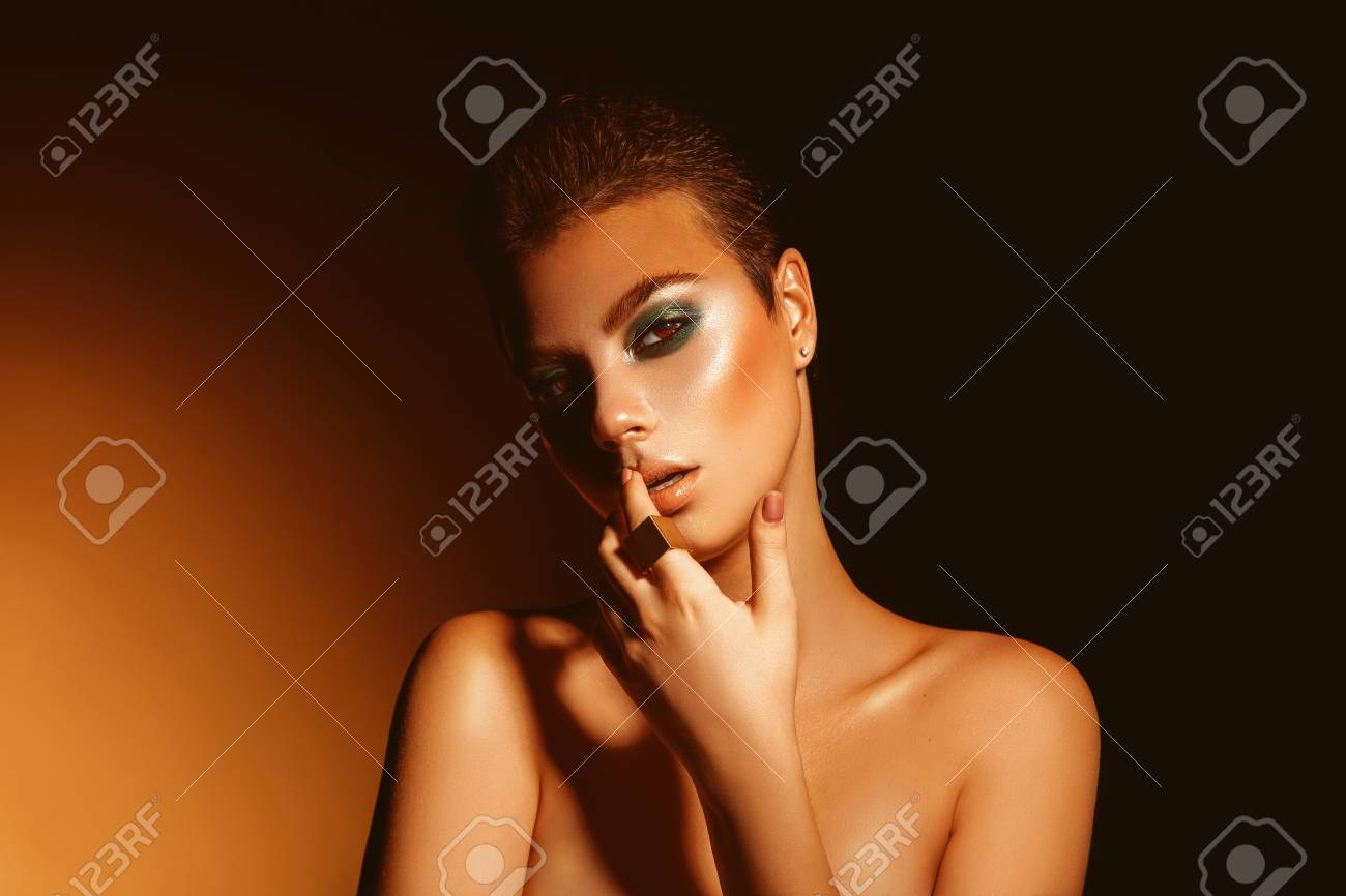 Sexy Adult Woman With Professional Green Colors Makeup And Short
