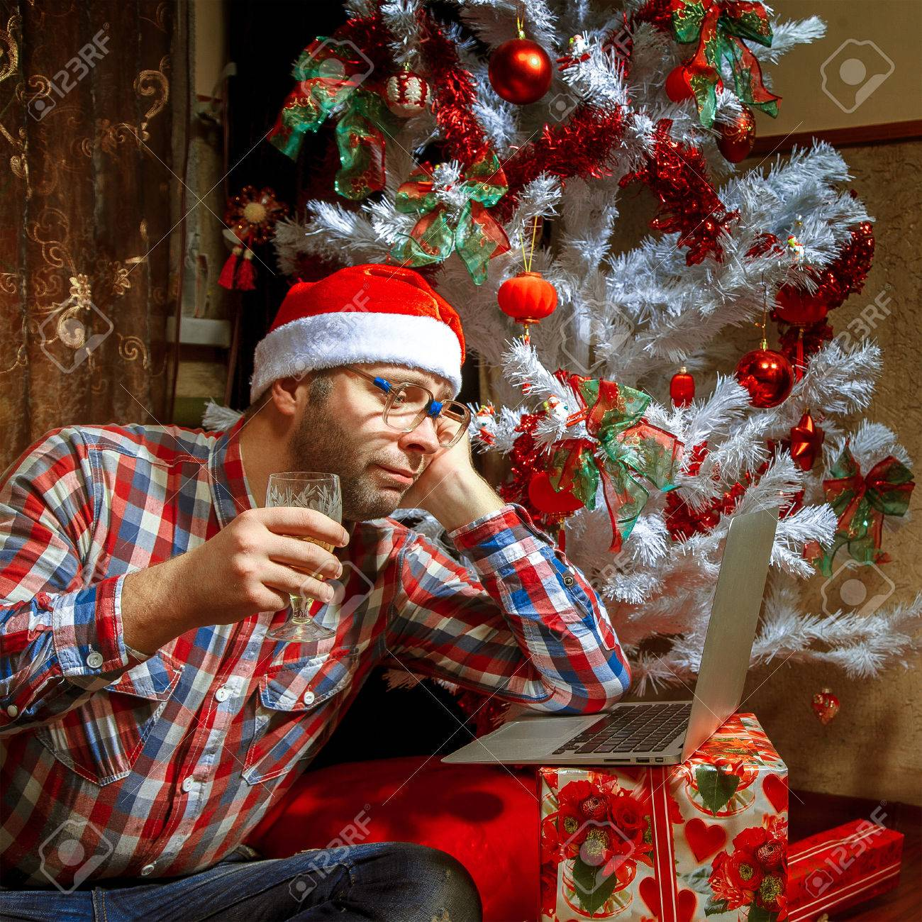 Lonely On Christmas.Lonely Christmas Nerd With A Laptop Under The Tree