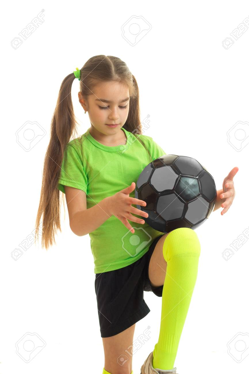 186a2faf8 little blonde girl in sport uniform playing with soccer ball isolated on  white background Stock Photo