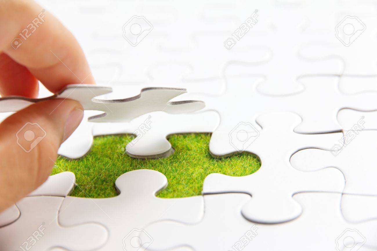 hand holding a puzzle piece, green space concept - 17750157