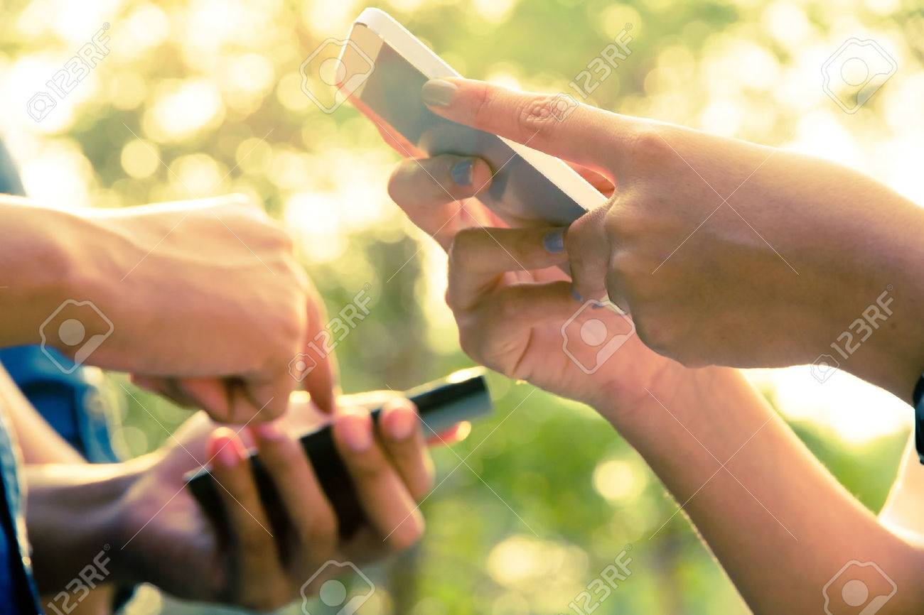 Teenagers With Mobile Phone Stock Photo - 26549630