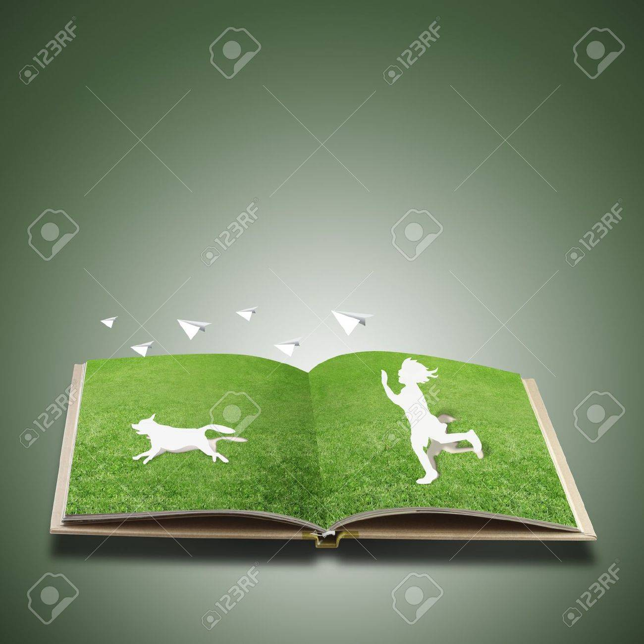 Paper cut of children play on grass book Stock Photo - 12817456