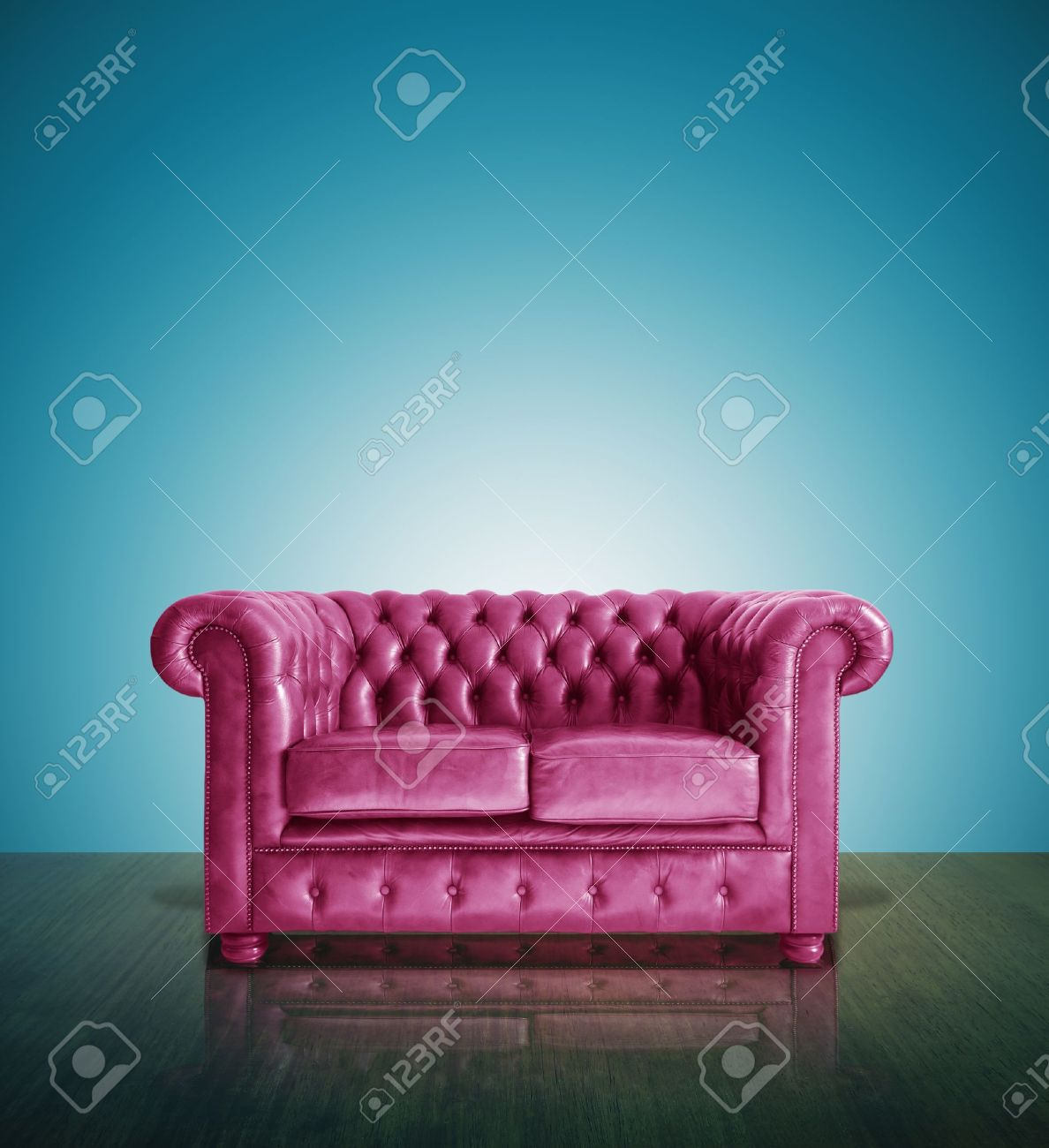 Classic Pink Leather Sofa And Blue Background Stock Photo Picture
