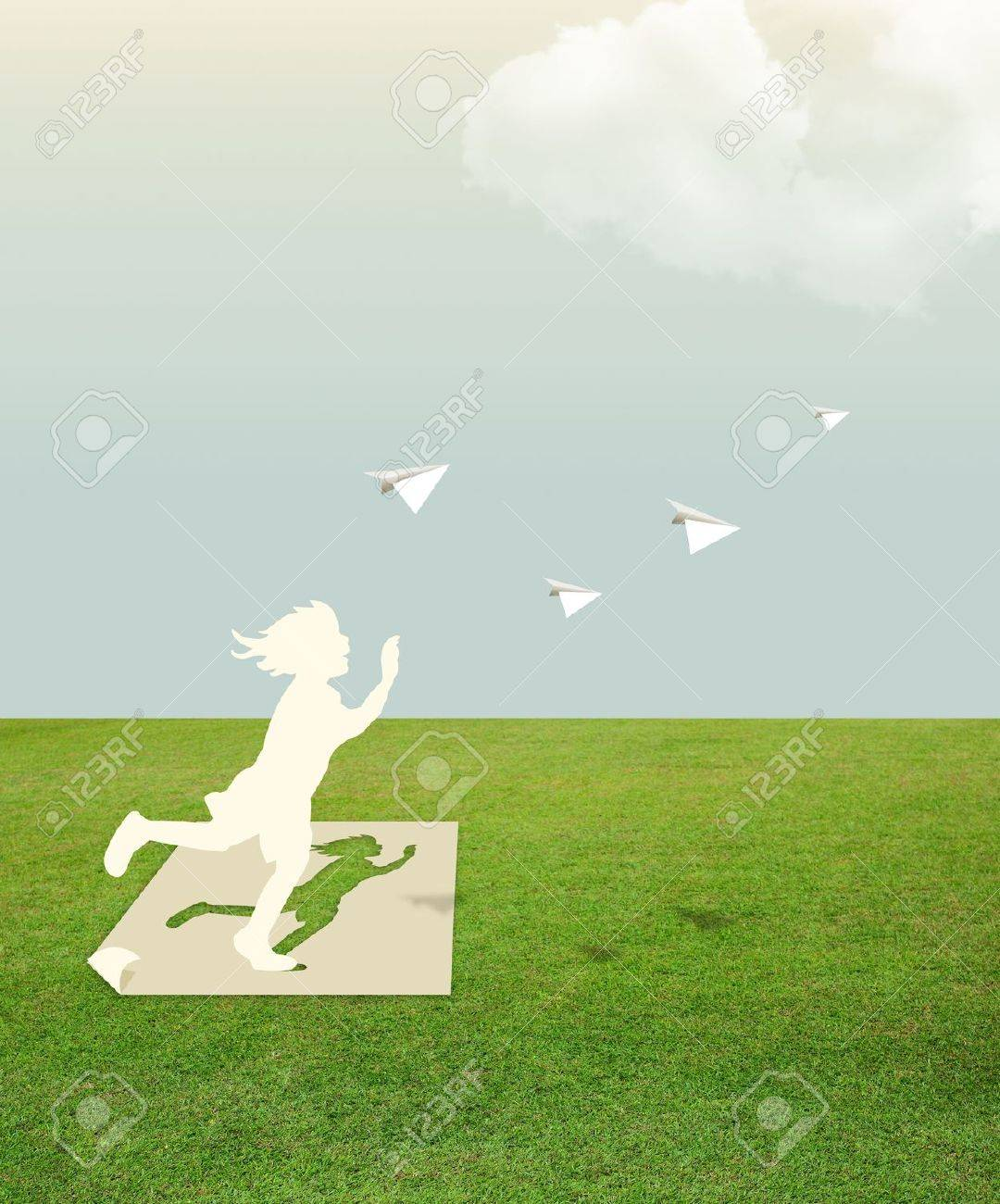 Paper cut of child on green grass dream concept Stock Photo - 14835597