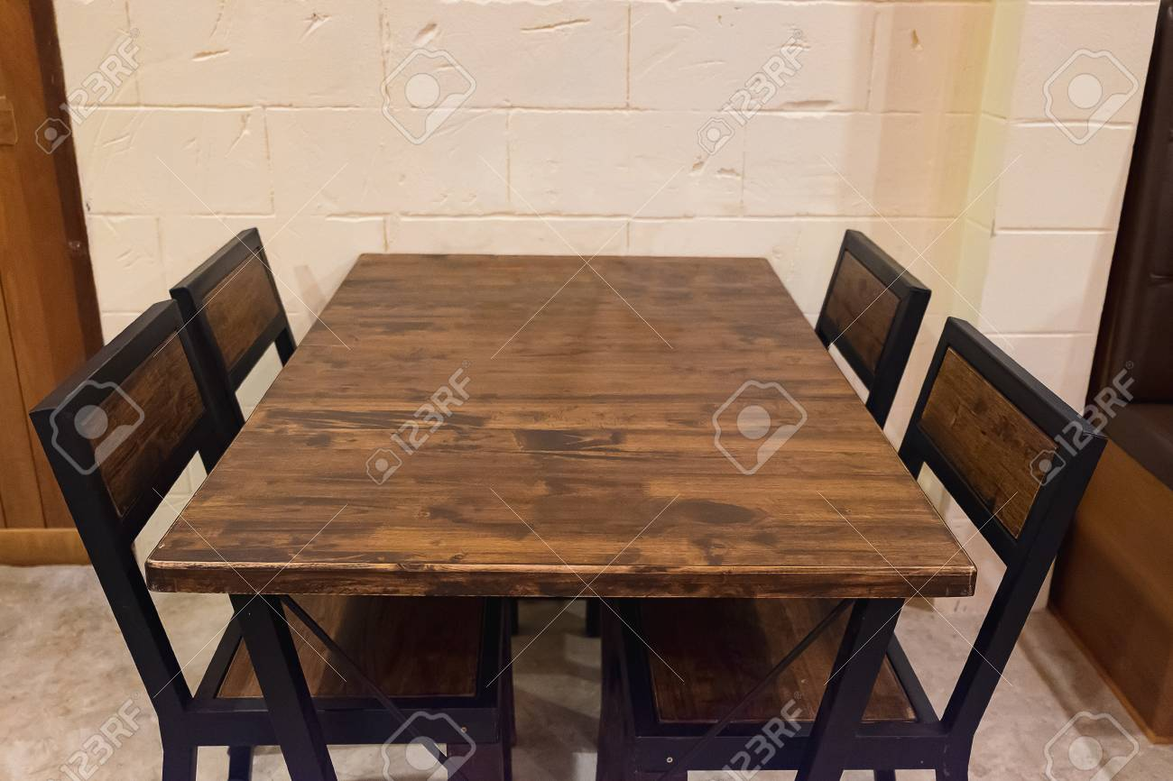 Picture of: Oak Dining Table With Chairs In Dark Room Wooden And Black Metal Stock Photo Picture And Royalty Free Image Image 71574041
