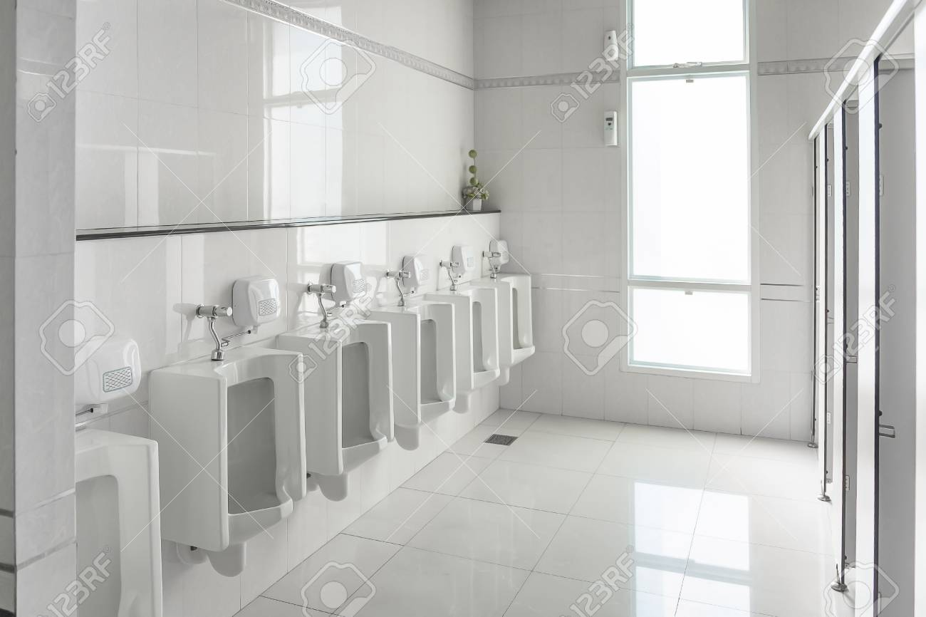 White Urinals In Clean Men Public Toilet Room Empty With Big.. Stock ...