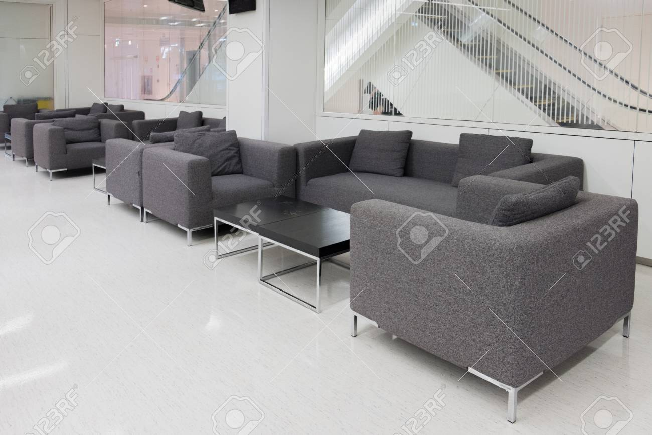 Dark Grey Fabric Sofa In Waiting Room Or Contemporary Office