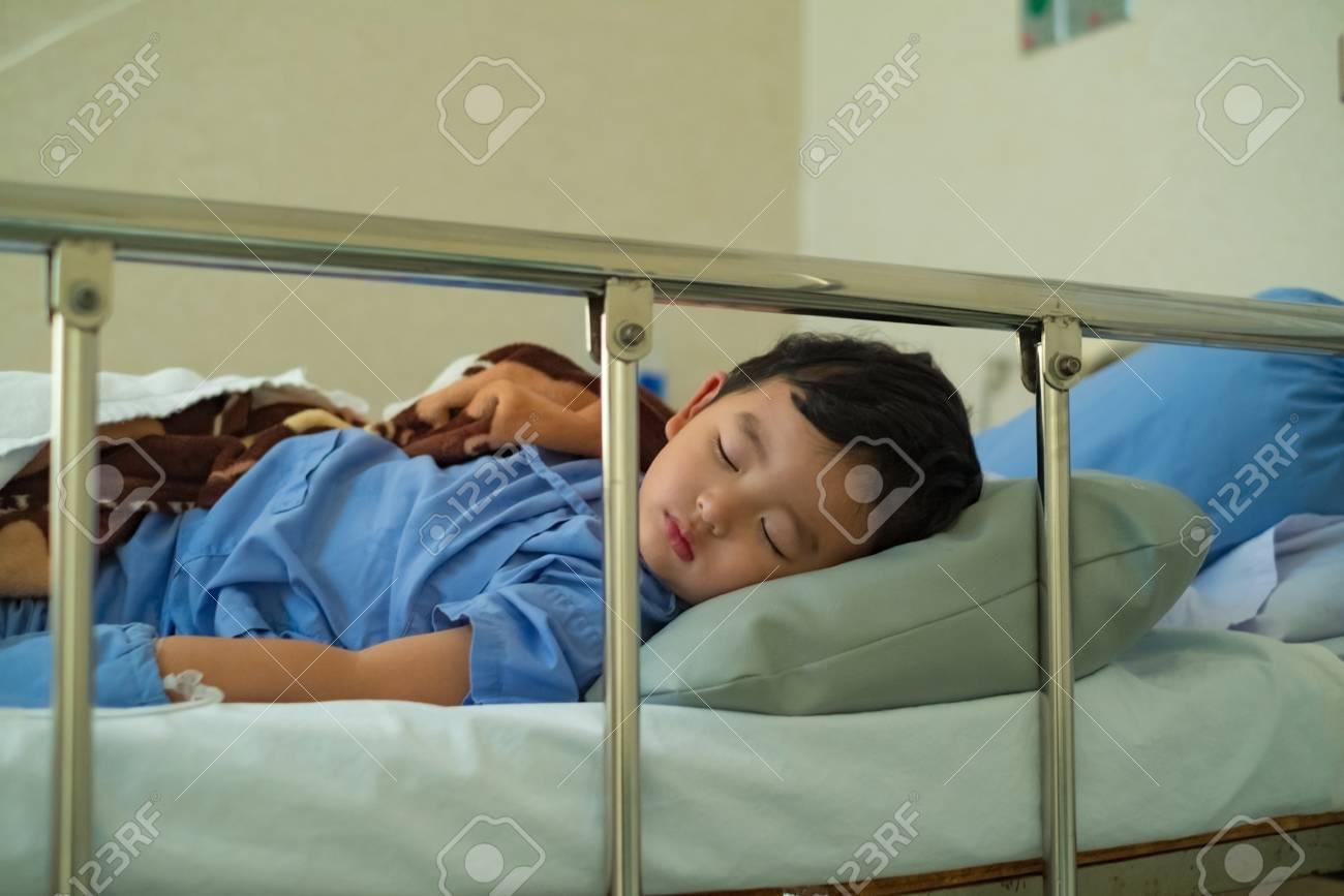 Sick Asian Kid Boy 2 Years Old Lying Sick In Hospital Bed Dim Light