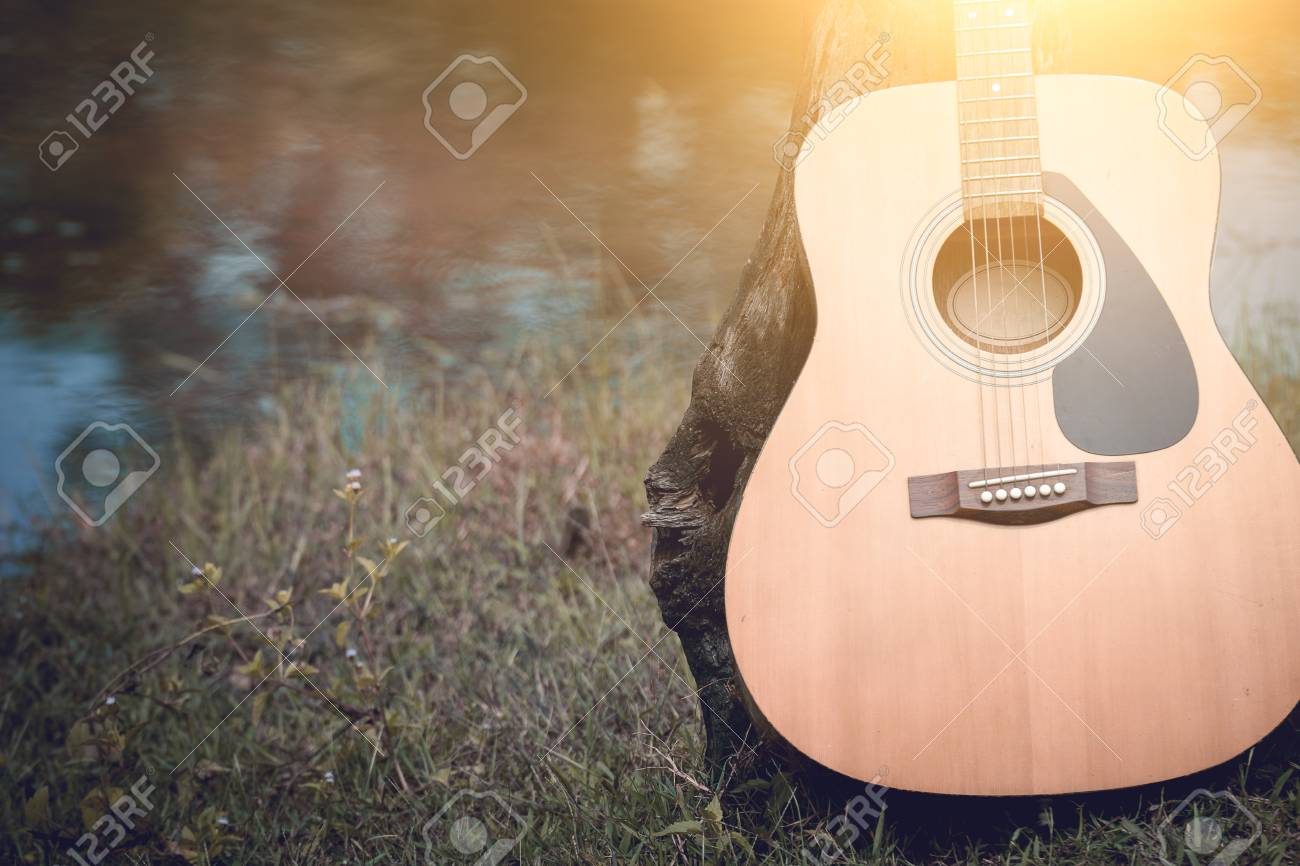 Acoustic Guitar Background On Riverside Stock Photo Picture And