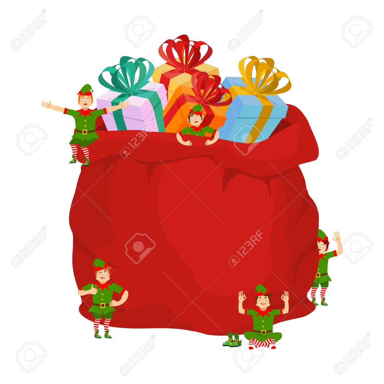 バッグの贈り物やクリスマスのエルフとサンタ玩具や子供用のお菓子が