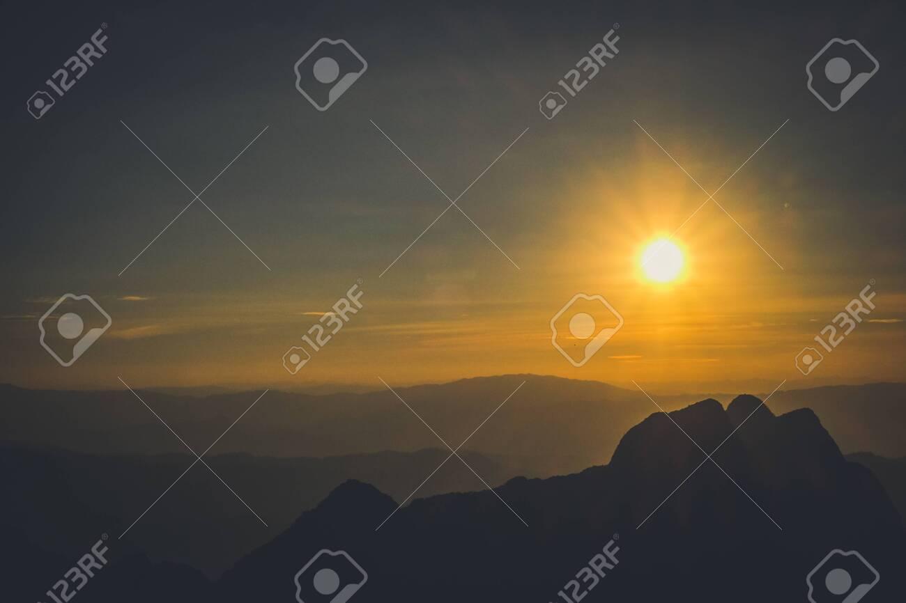 sunrise sky backlit with big mountain - 144025979