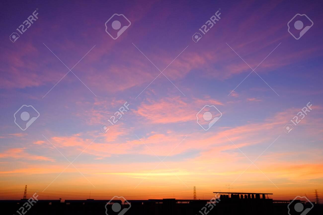 sunset sky shading background from orange to blue - 144040786