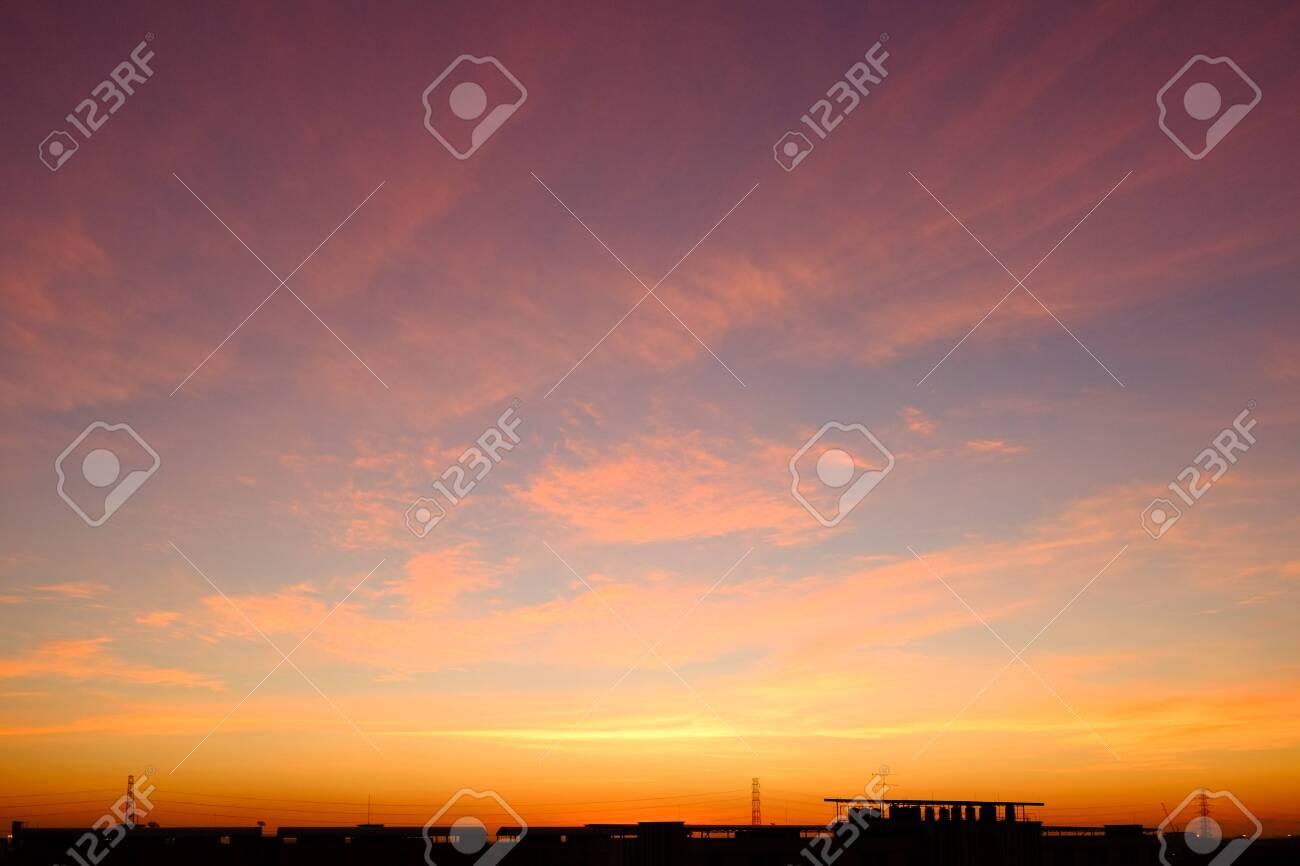 sunset sky shading background from orange to blue - 144040790