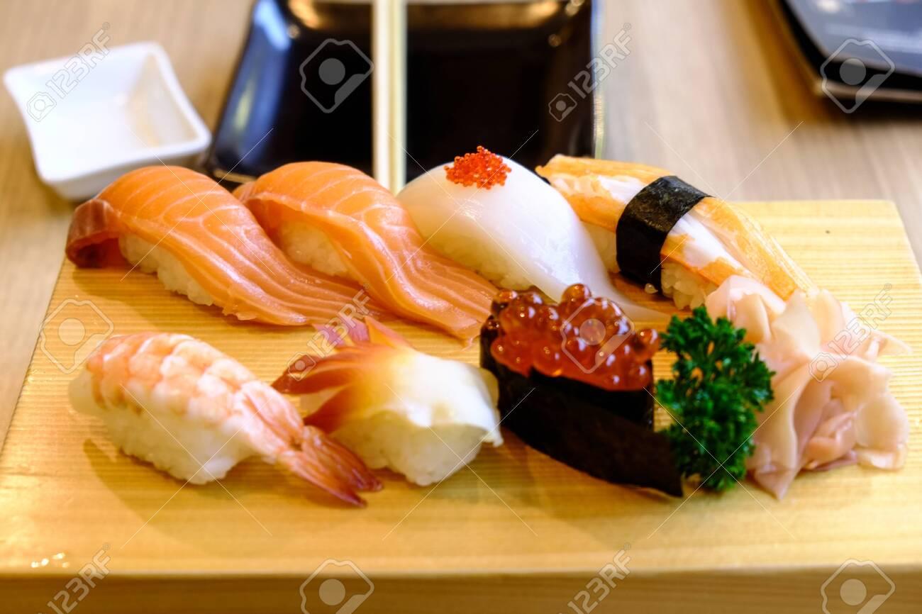 sushi set in the japanese wood dish - 144043958