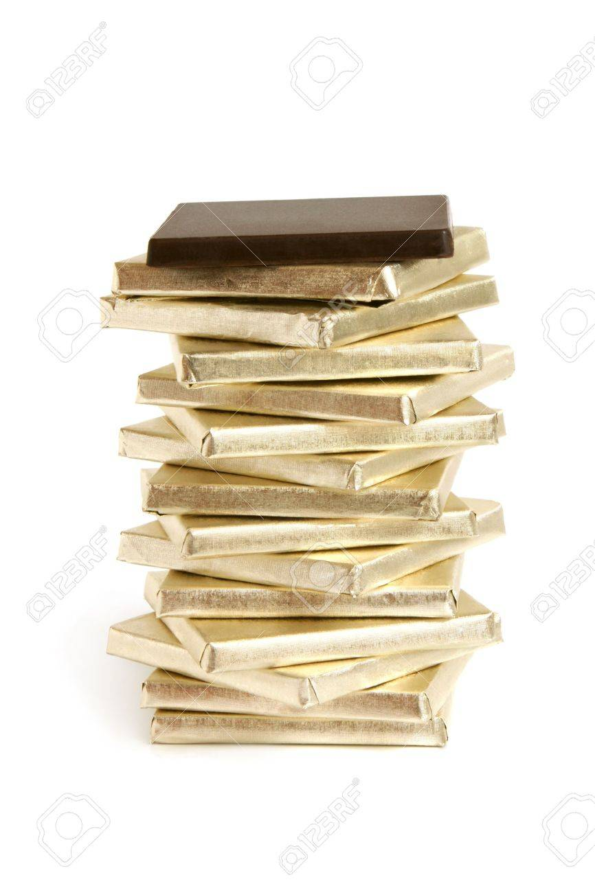 Stack of chocolate pieces on a white background Stock Photo - 8447820