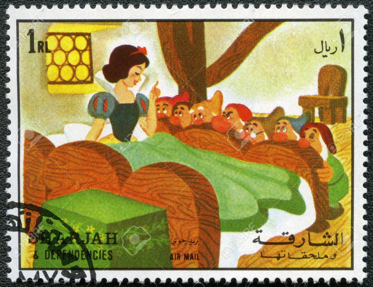 SHARJAH & DEPENDENCIES - CIRCA 1972: A stamp printed by Sharjah & Dependencies devoted fifty years of Walt Disney cartoon characters, shows Snow White and the seven dwarfs, series, circa 1972 Stock Photo - 12505421