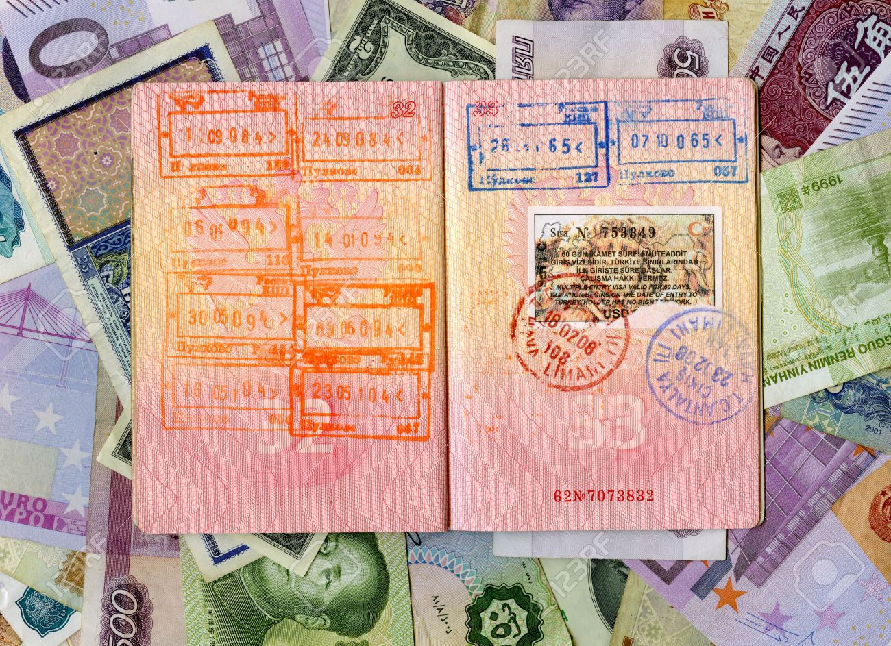 Passport With Turkish Visa And Stamps On A Different Money Background Stock  Photo, Picture And Royalty Free Image. Image 12505393.