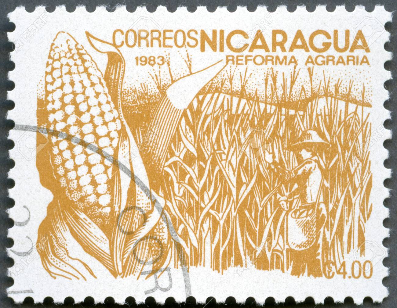 NICARAGUA - CIRCA 1983  A stamp printed in Nicaragua shows image of agrarian reform, Corn, circa 1983 Stock Photo - 13587011