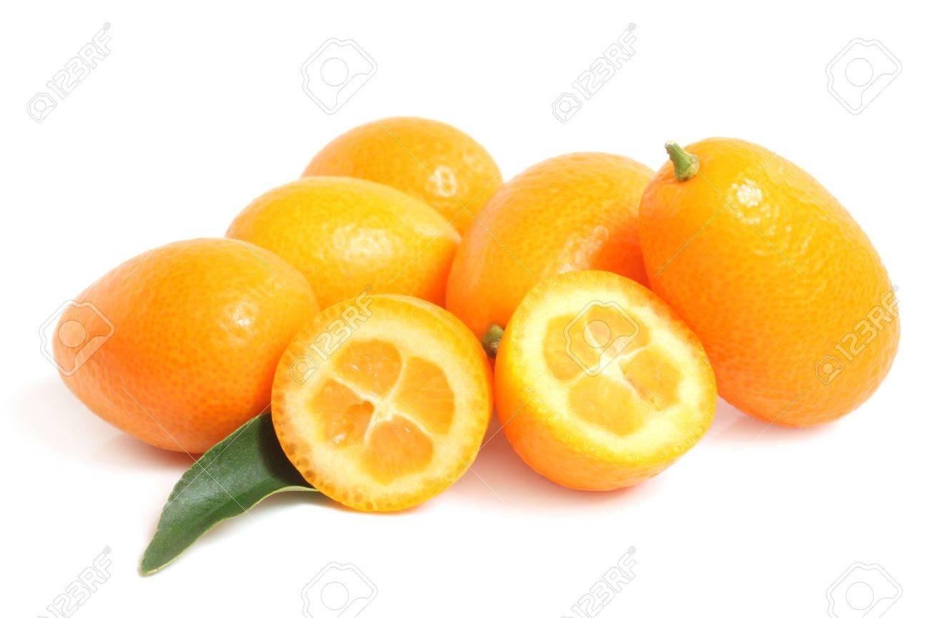 Kumquat with leaf on a white background Stock Photo - 19468433