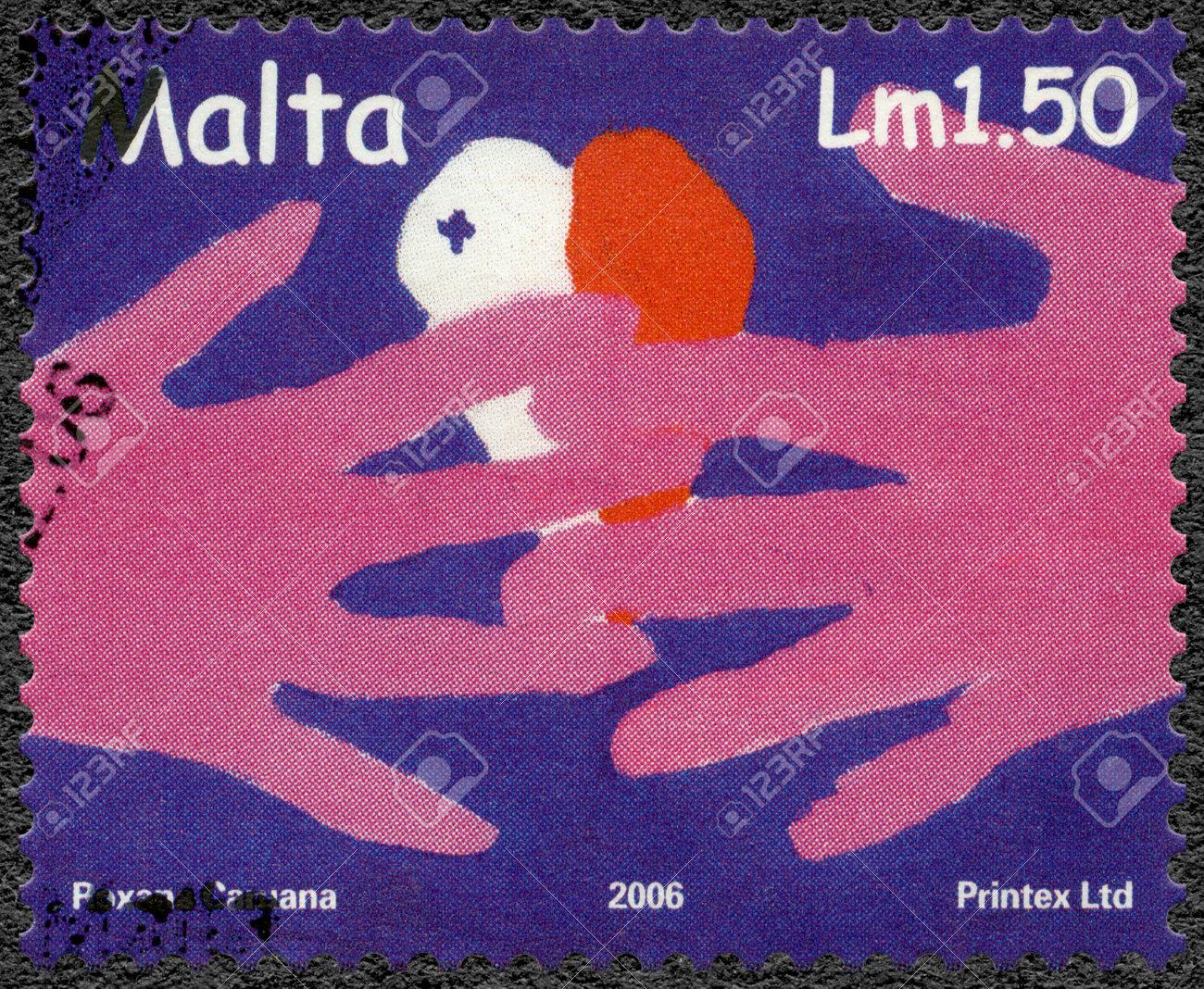 MALTA - CIRCA 2006: A stamp printed in Malta shows YMCA Valletta