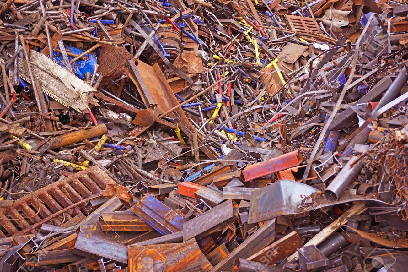 Scrap metal. Scrap. Mountains of metal trash. Waste of human activity. - 144824021