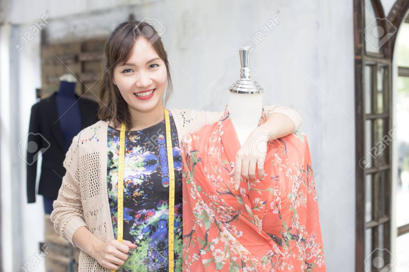 Beautiful Young Asian Designer In Her Dress Fashion At Showroom Stock Photo Picture And Royalty Free Image Image 79218794