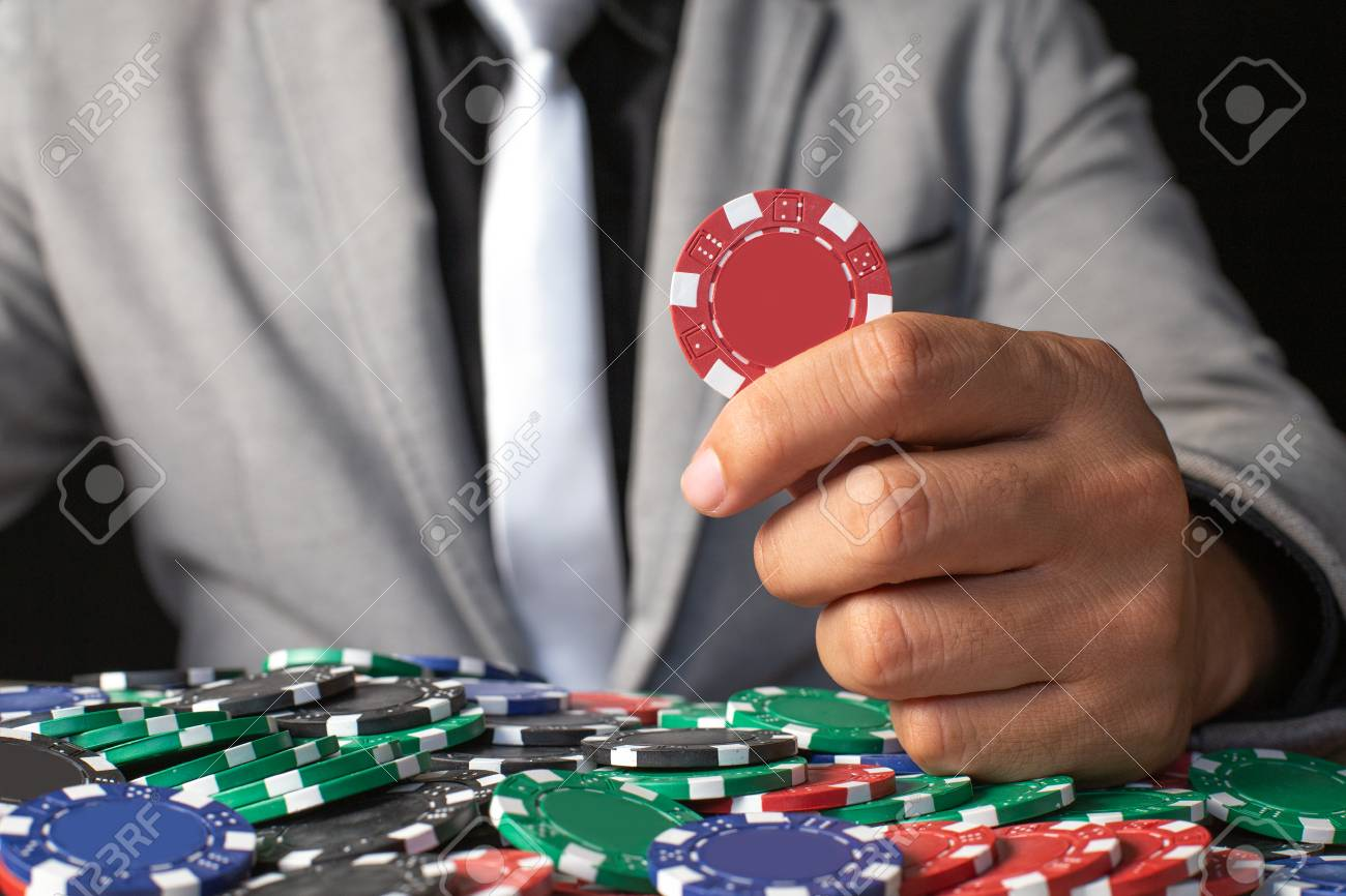 Man Holding Chip Coin Isolated On Black Background. Casino And Broker  Concept. Stock Photo, Picture And Royalty Free Image. Image 104298728.