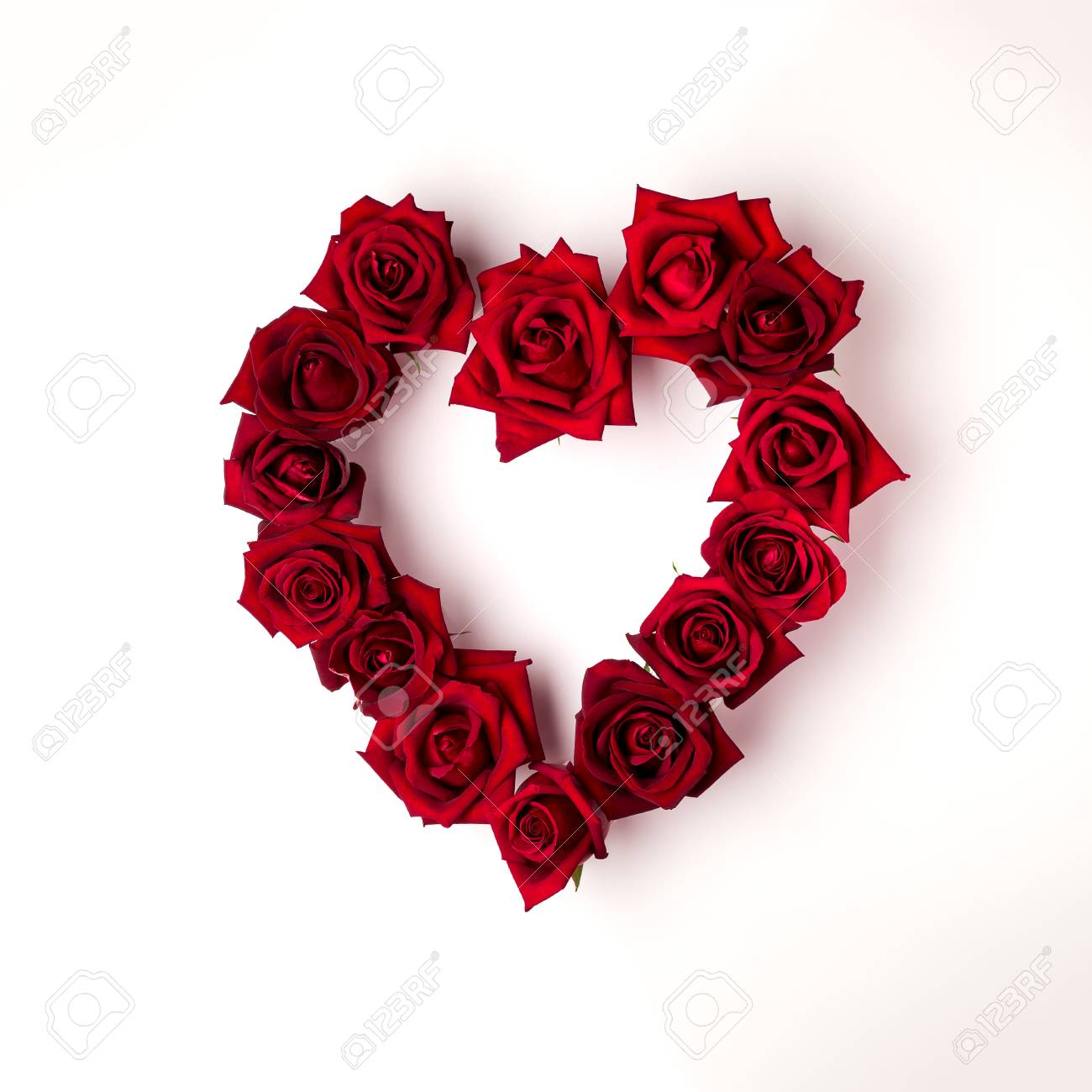 Top View Image Of Heart Shape Red Rose Flowers On White Background
