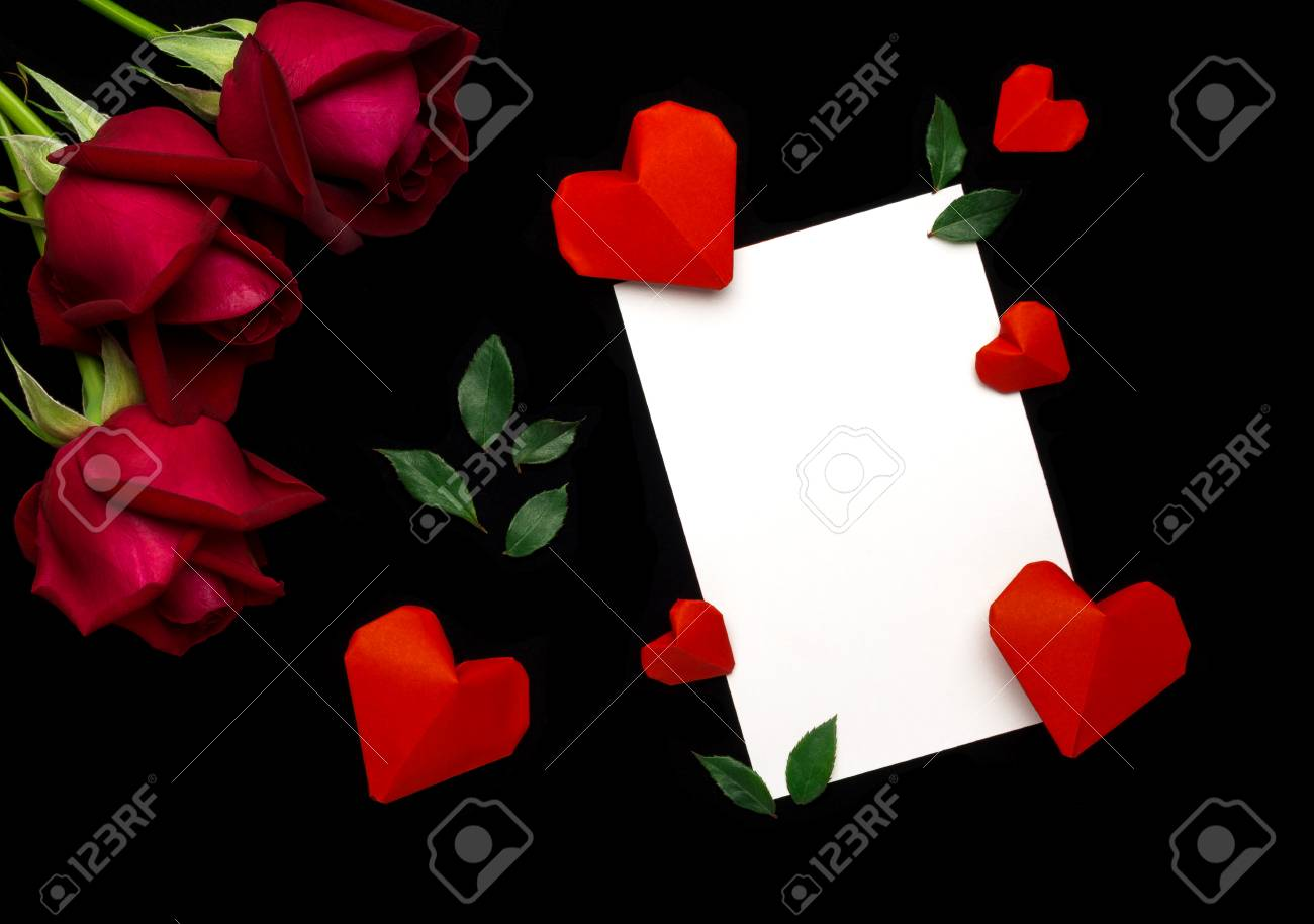 Top View Flat Lay Image Of White Paper Note Red Rose Green