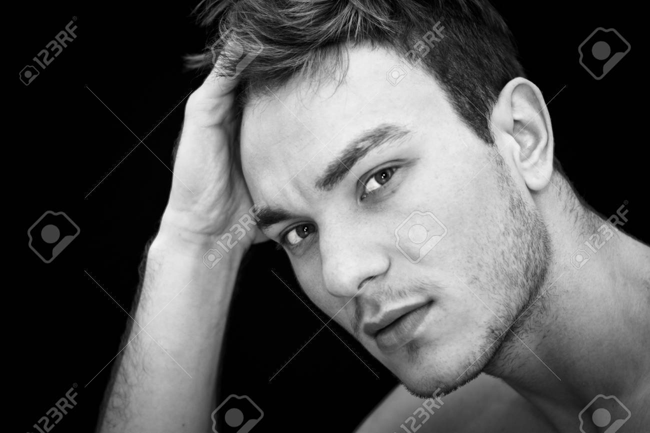 Portrait of young man thinking, black background Stock Photo - 11322237