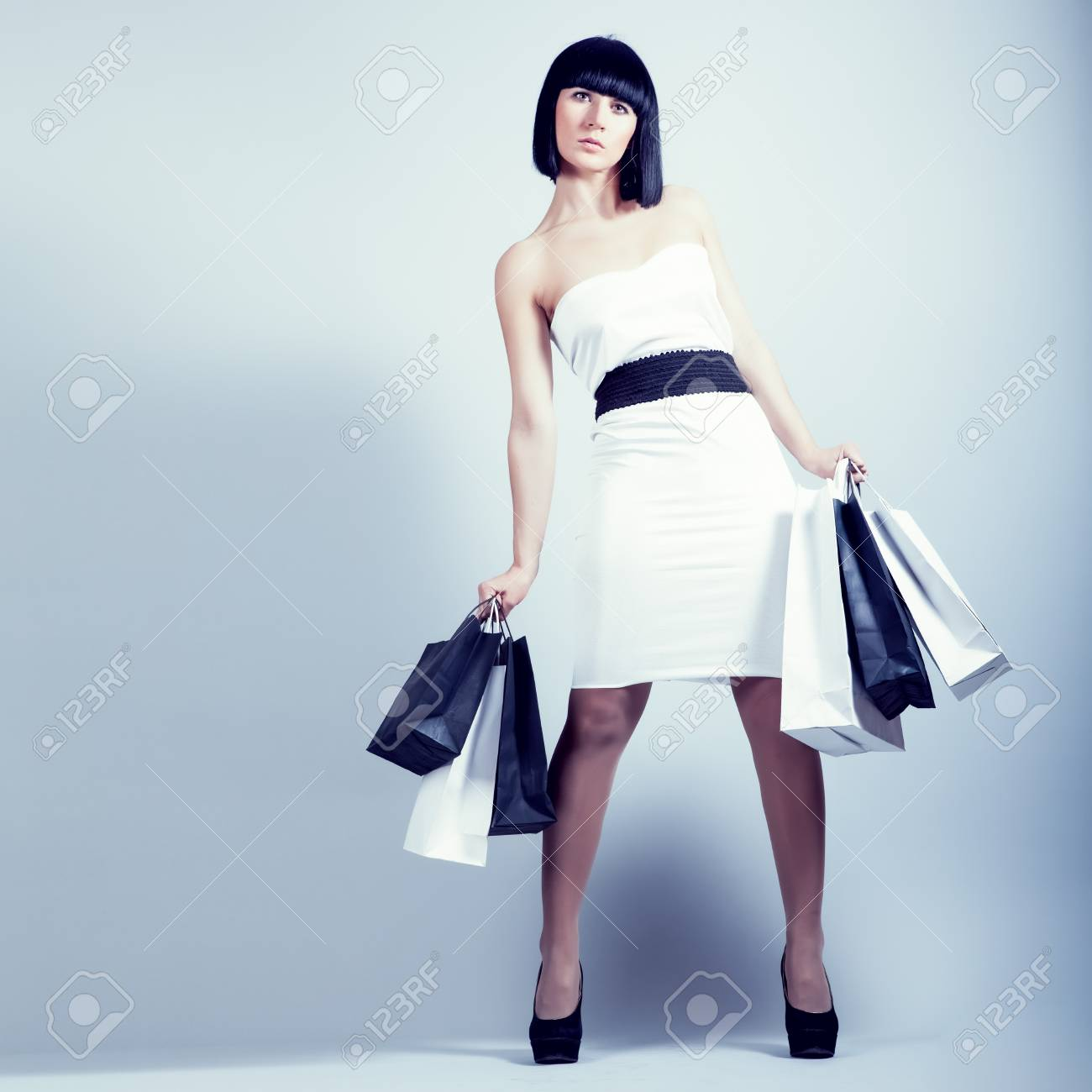 happy shopping girl holding bags Stock Photo - 13058059