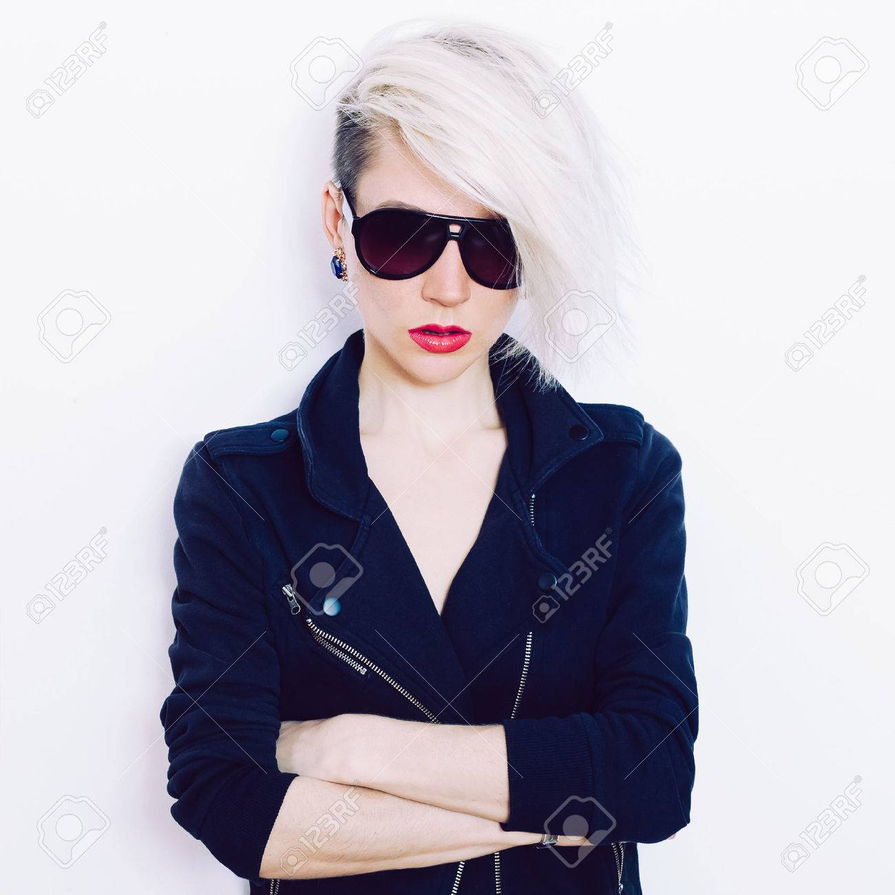 Blonde girl with trendy hairstyle and fashion sunglasses - 38635375