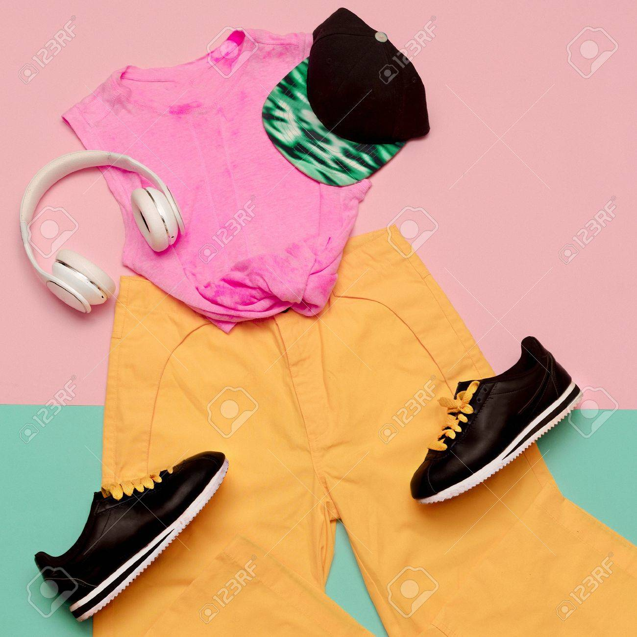 7832d627 Flat lay fashion sports outfit set: shoes sneakers, trousers and top bright  background.