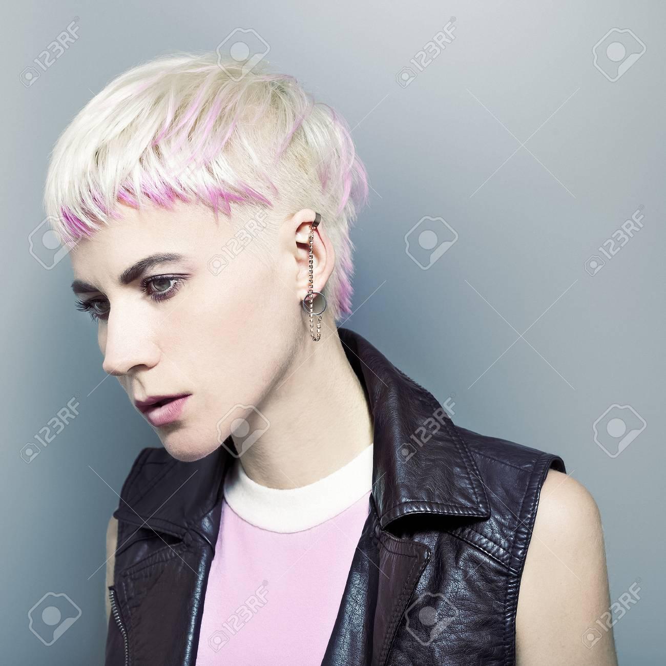 Stylish blonde with short hair. Rock fashion style