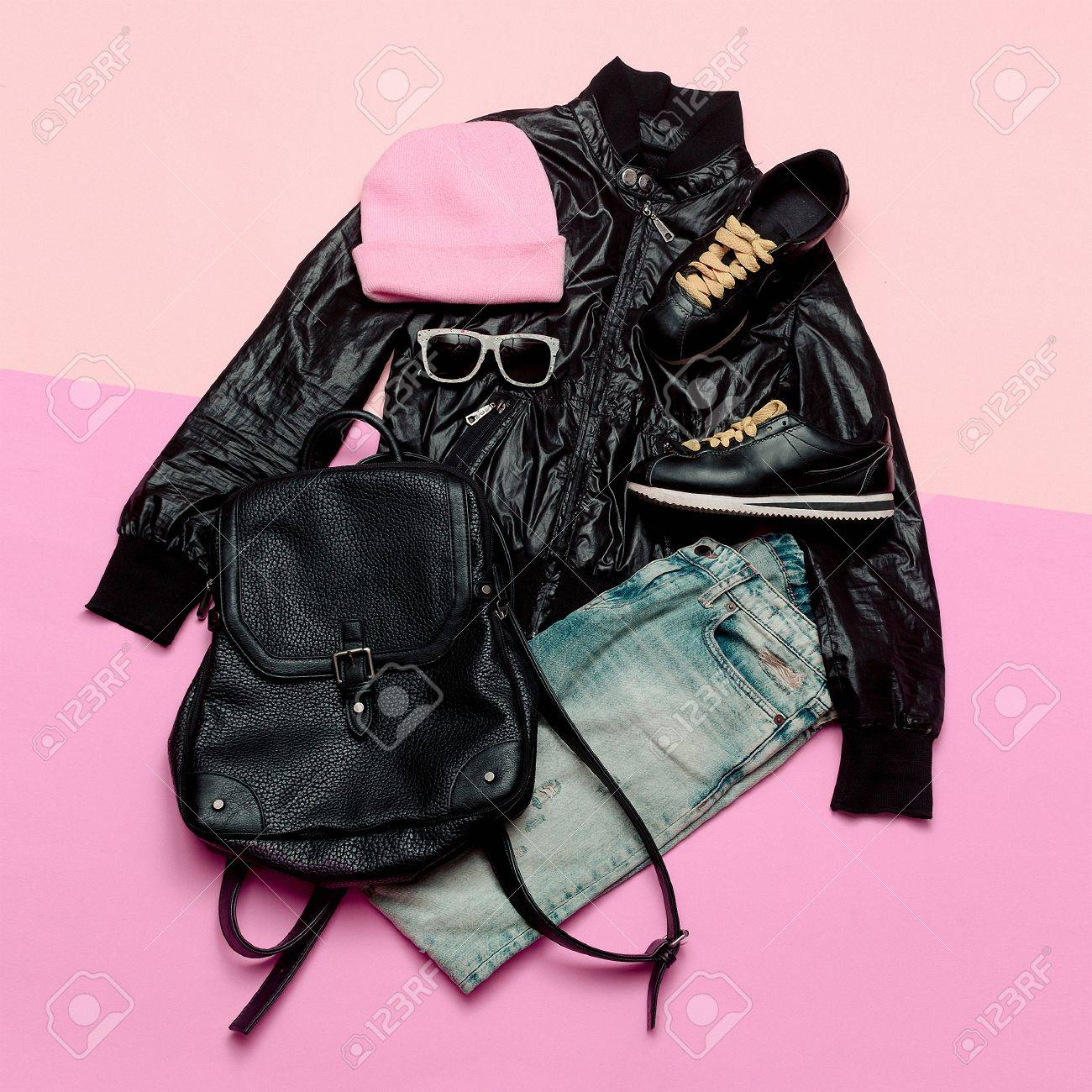 75e818281ed Hipster Urban Outfit girl. Stylish black clothes and bright accessories.  Stylish backpack and beanie
