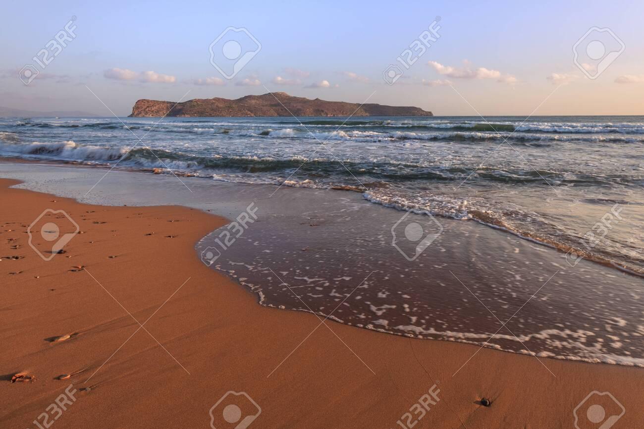 sunrise on the beach in Crete island, Greece - 121193069