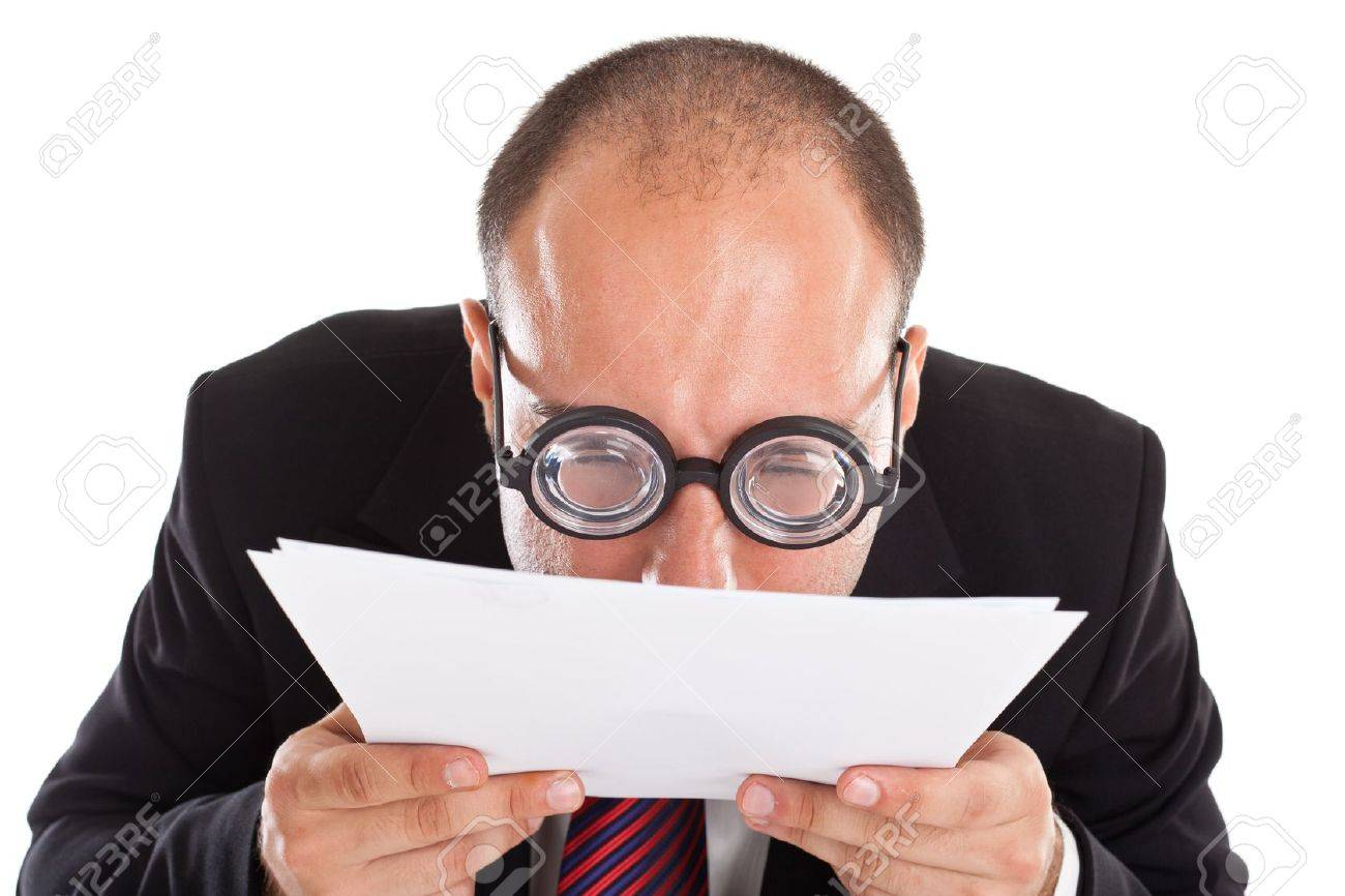 A businessman wearing thick, circle glasses tryng to read some documents Stock Photo - 18994184
