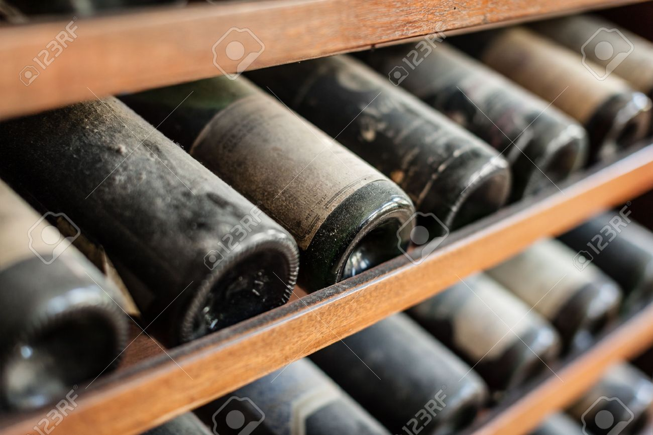 ancient wine bottles dusting in an underground cellar Stock Photo - 20435735
