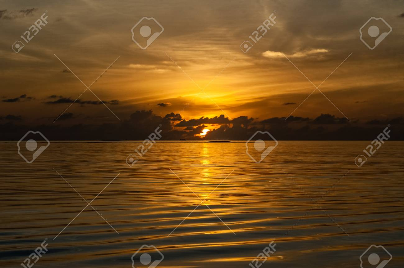 a beautiful and vibrant tropical sunset over a calm and clean sea Stock Photo - 20435306