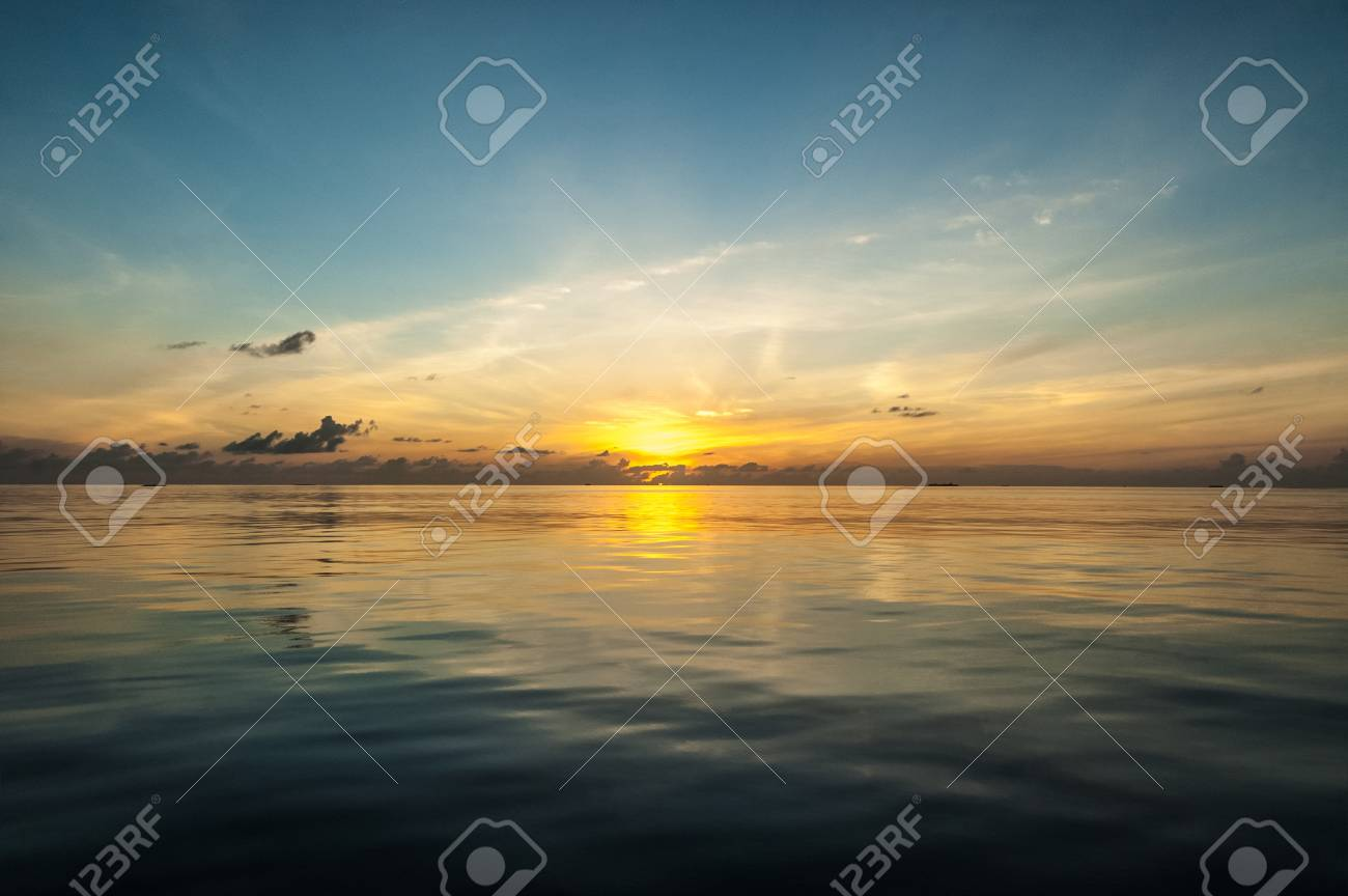 a beautiful and vibrant tropical sunset over a calm and clean sea Stock Photo - 20435333