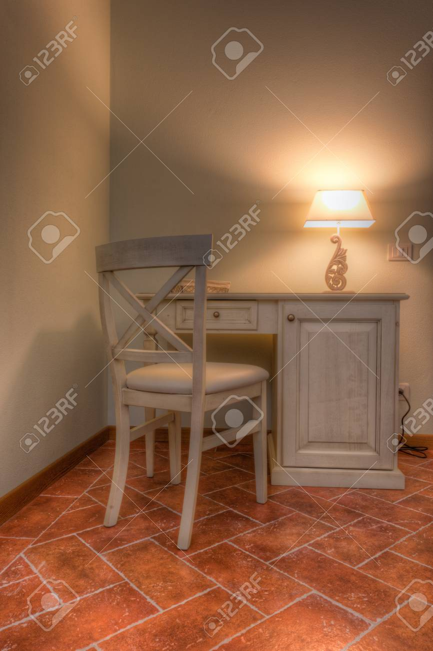 a vintage desk with a chair and a lamp Stock Photo - 20564416