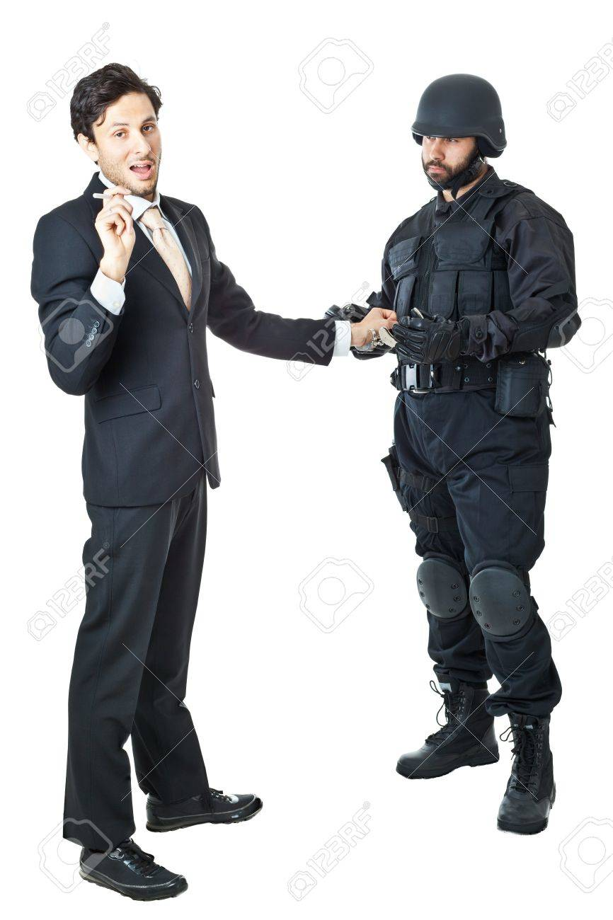 a corrupted businessman being arrested by a swat agent Stock Photo - 20761364