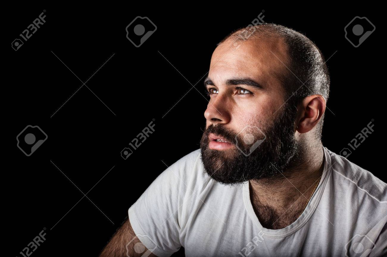 a masculine bearded man isolated over a black background Stock Photo - 23336899