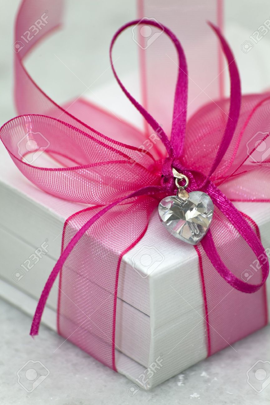 A White Box Tied With A Pink Satin Ribbon Bow A Gift For Christmas