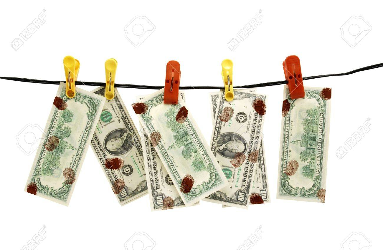 Dirty dollars is dried on linen rope Stock Photo - 9358328
