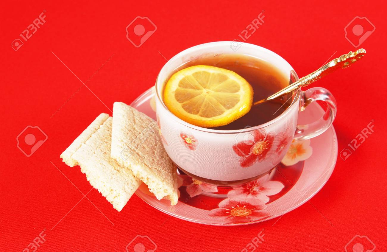 Cup of black tea with a lemon on a red cloth Stock Photo - 9373665